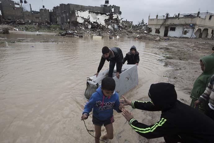 Chidren in a flooded street, in Gaza. December 2014.