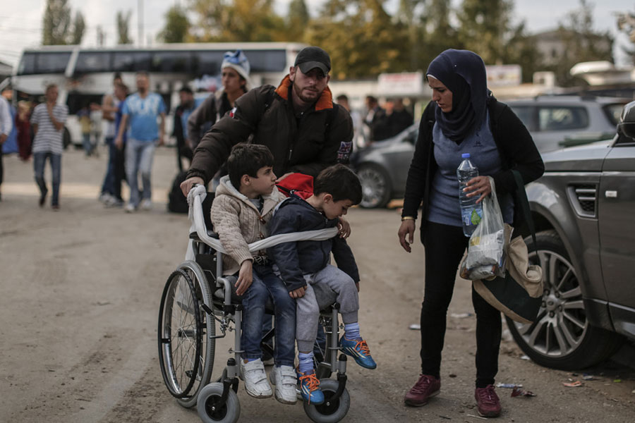A refugee family wait in Serbia to continue their journey on to Germany