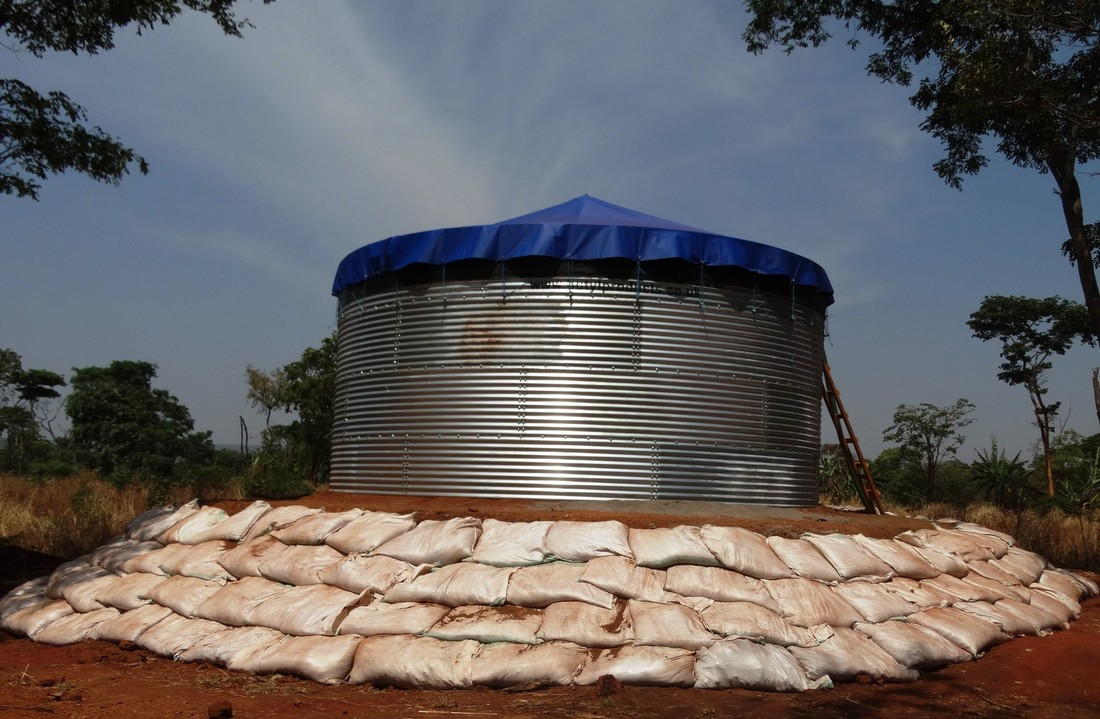 An Oxfam water tank under construction, Nduta camp, Tanzania