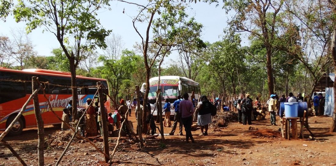 Burundian refugees arrive by bus at Nduta camp, Tanzania