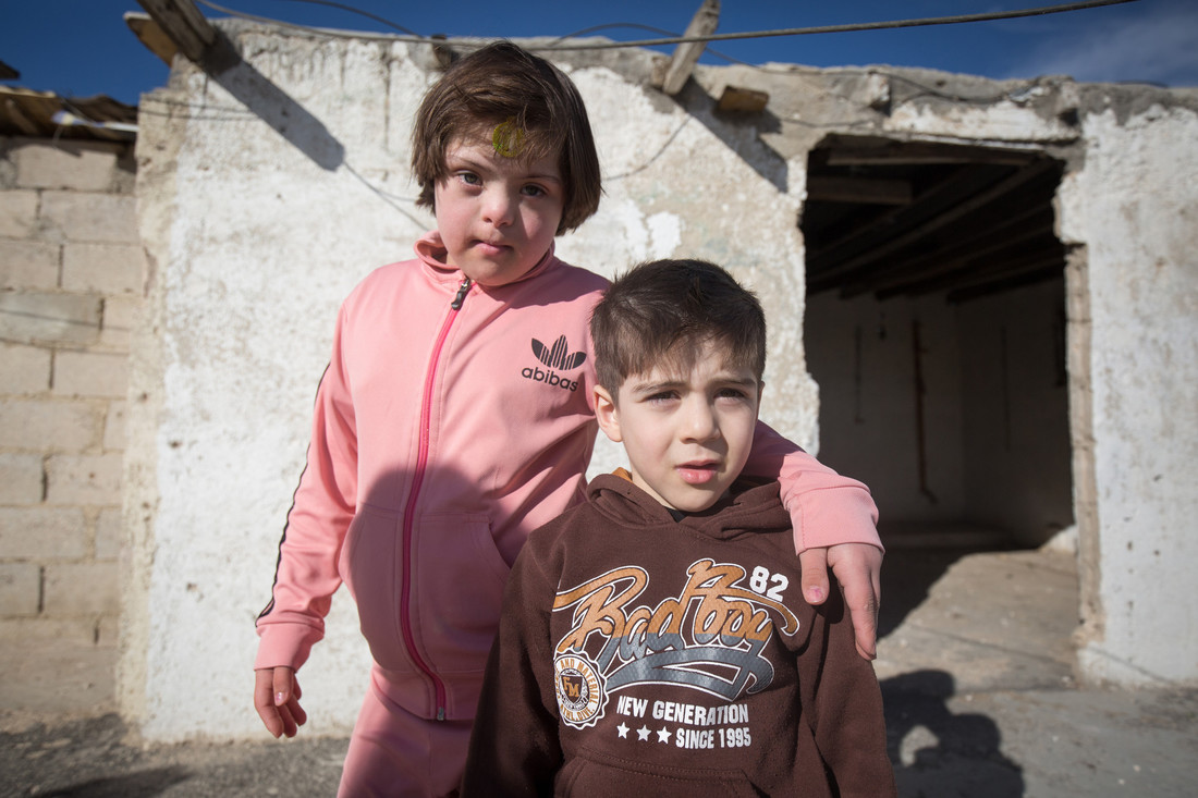 A brother and sister stand together, Za'atari refugee camp, Jordan