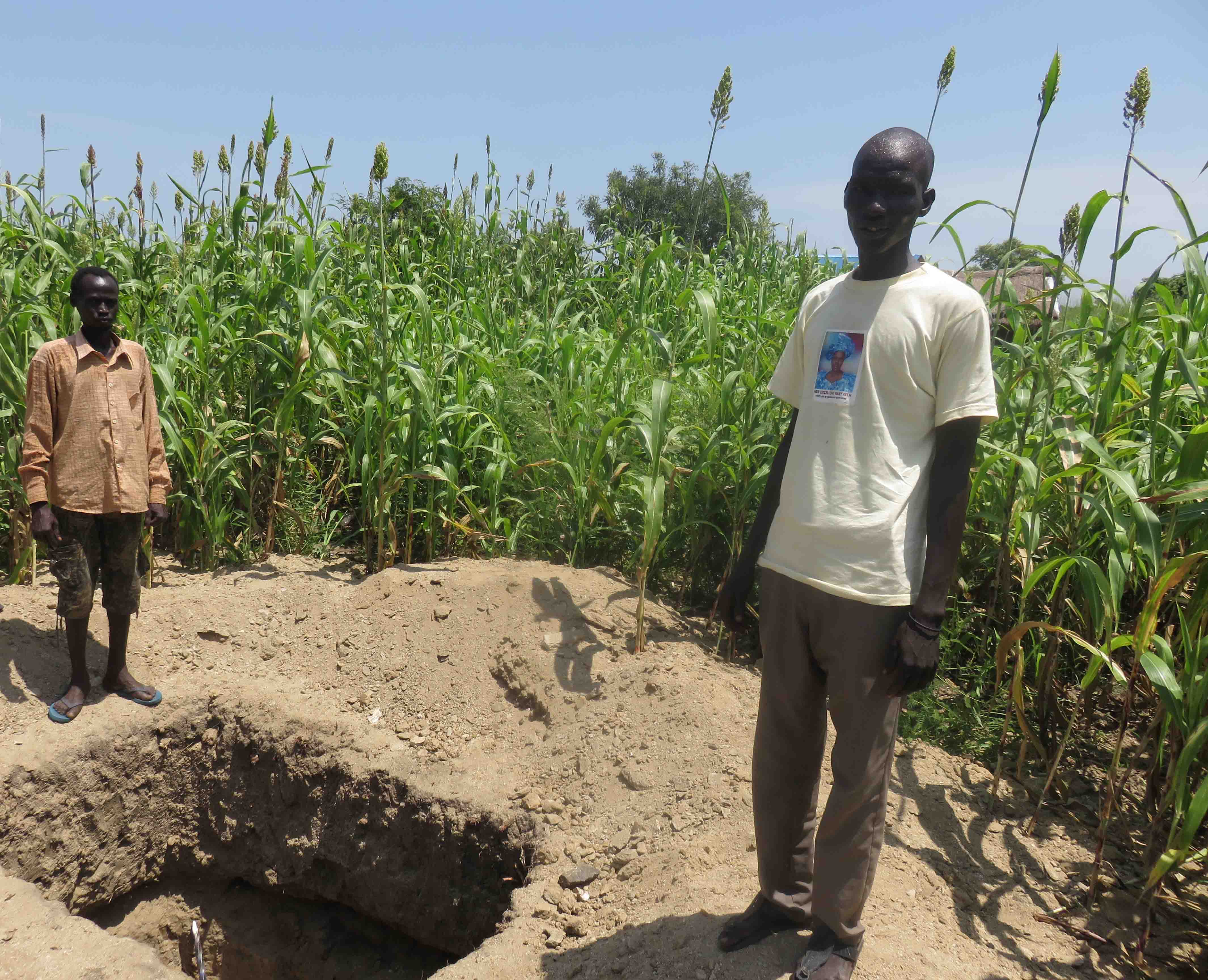A young man builds latrines with Oxfam's help in Juba, South Sudan