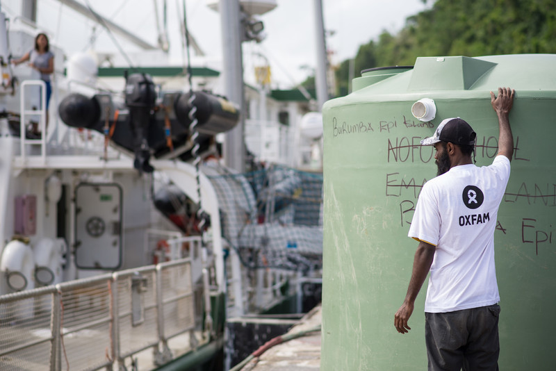 Water tanks from Oxfam being loaded on Rainbow Warrior at Port-Vila, Vanuatu. Photo credit: Groovy Banana/Oxfam AUS