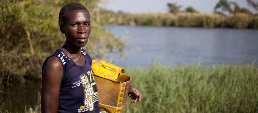 Barbara Chinyeu (36) is a widow who risks her life every day to irrigate her crops and feed her two children.