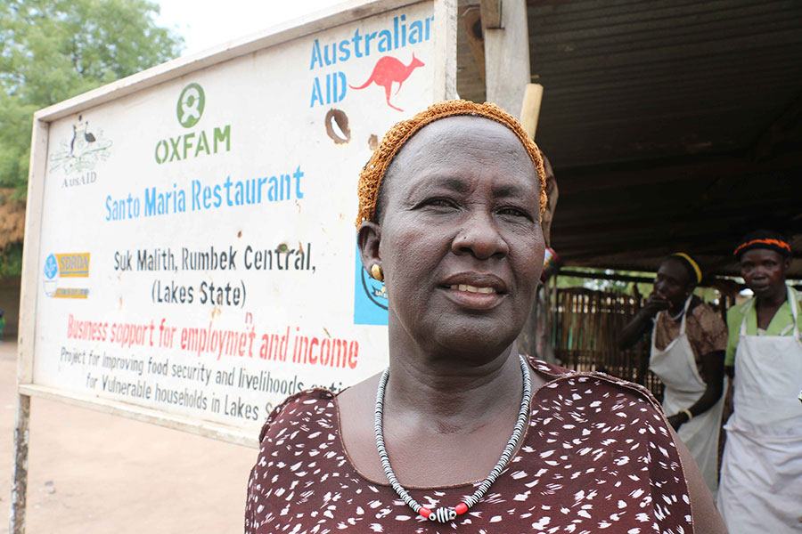 A business woman stands outside her restaurant in South Sudan