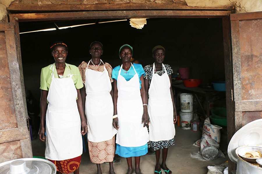 Staff members stand outside their restaurant in Rumbek, south Sudan