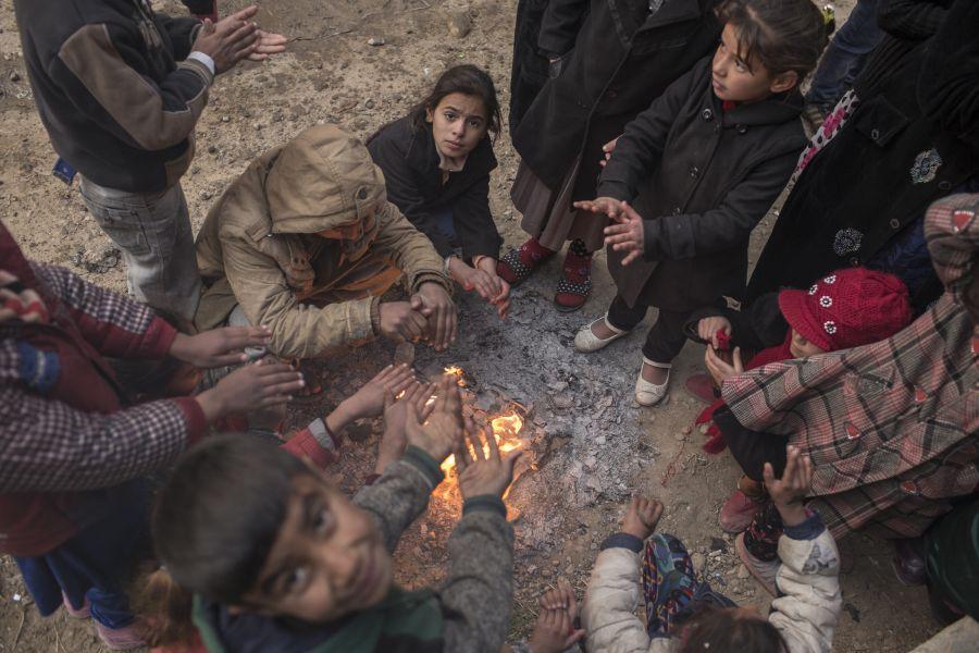 Distribución de mantas y ropa de abrigo en Irak.
