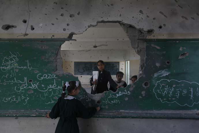 Children in a school in Gaza damaged by the Israeli attacks