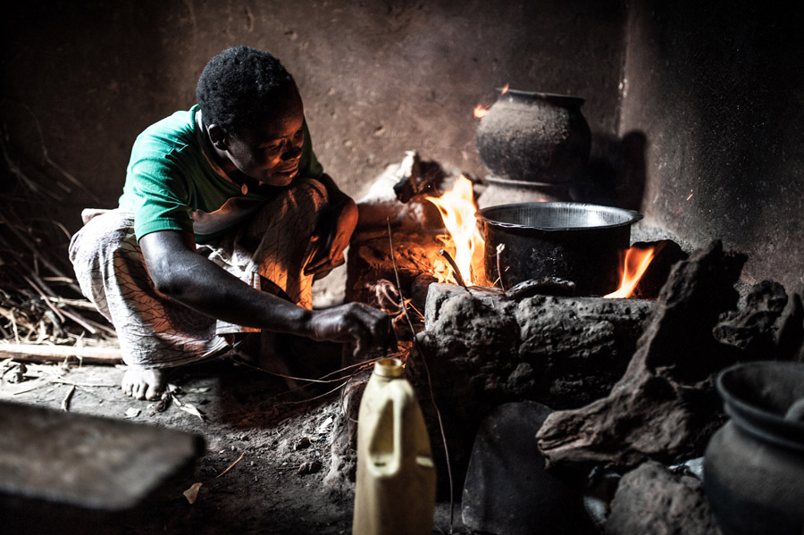 """When using firewood, I must stay close to the cooking stove to check over the fire"", Christina says. Photo: Oxfam"