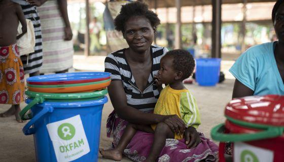 Margaret, 27, sits with her son, Jolly*, in the Bangula camp, in southern Malawi, where she took shelter after she lost her home with the flooding caused by Cyclone Idai. Photo: Philip Hatcher-Moore/Oxfam