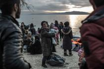 Safe on shore, refugees who made it to the Greek island of Lesbos in February 2016 plan for the next step of their long trek to safety. Photo: Pablo Tosco/Oxfam