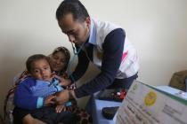 Dr Ihab Dabour checks Sawsan's son Ameer at a mobile clinic in Gaza