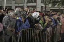 Refugees wait to register for a travel permit in Serbia