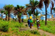 Burundian refugees carry jerrycans of water inside the Lusenda camp, Democratic Republic of Congo