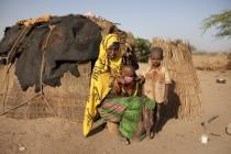 Habodo outside her shelter with two of her children, Habiiba* (3 ½ months) and Saafi* (6), near Bisle, Siti Zone, Ethiopia.