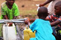 Children collecting water from taps, Bulengo camp, DRC. Photo: Eddy Mbuyi/Oxfam
