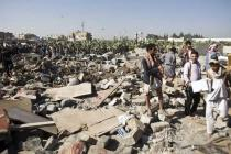 People search for survivors under the rubble of houses destroyed by Saudi airstrikes near Sanaa Airport, Yemen, March 26, 2015. Credit: Abo Haitham