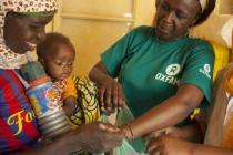 Baby being examined for malnutrition in Niger