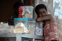 A young street vendor selling candy in Lagos, Nigeria. Photo: Mies van der Putte/Oxfam