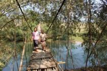 Two women crosss a bridge, Laos