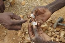 Families are increasingly resorting to trying to make a small income from the gold fields. Artisanal Gold-mining is labour intensive, using only very basic tools. The daily haul may just buy a dish of millet. Photo: Andy Hall/Oxfam