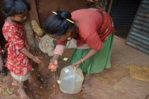 A mother and daughter wash fruit in Khadgabhanjyang, Nepal