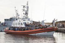 More than 500 migrants land at the military port of Lampedusa.