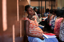 Ernistina Morgan sits in maternal health hospital Ghana