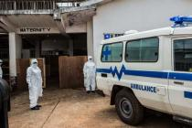 Health workers wait for a suspected Ebola patient, Rokupa Isolation Centre, Sierra Leone. Photo: Tommy Trenchard/Oxfam