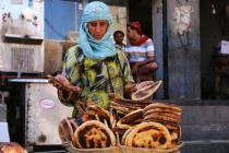 Marriam travels from Sabir Mount to the city centre to sell bread and earn an income. Most of the city's bakeries have closed.  Her grandchildren are reliant on her income after their parents died. Photo: Abdulnasser Al-Sedek/Oxfam