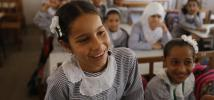 Nesma shares a laugh with her friends during class.