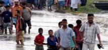 Gente huye de las inundaciones en India, agosto de 2012. Foto: Oxfam