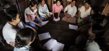 A group of women discuss in a village in Myanmar's Ayeyarwaddy Delta. Photo: Kaung Htet/Oxfam