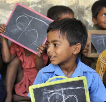 Boys with blackboards