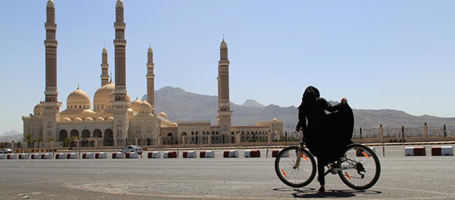 "A Yemeni woman is biking in Sanaa, during the operation ""Bike for Yemen"""