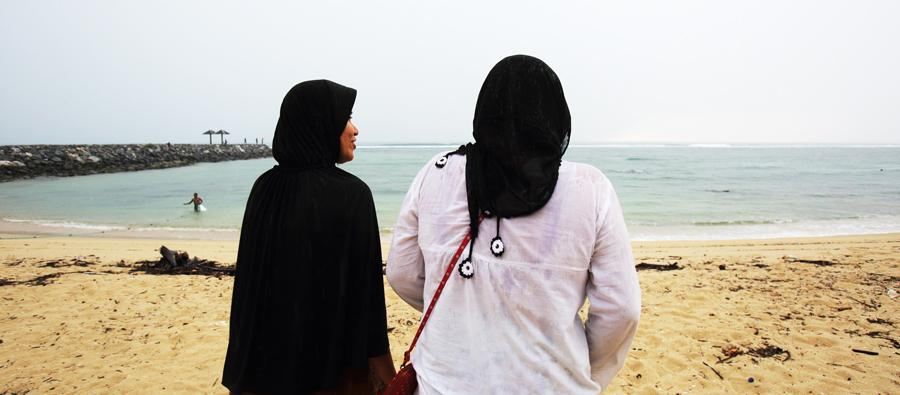 Noni and Nina, two sisters, are facing the sea in Aceh, Indonesia, 10 years after the tsunami which hit the region. Photo: Jim Holmes/Oxfam