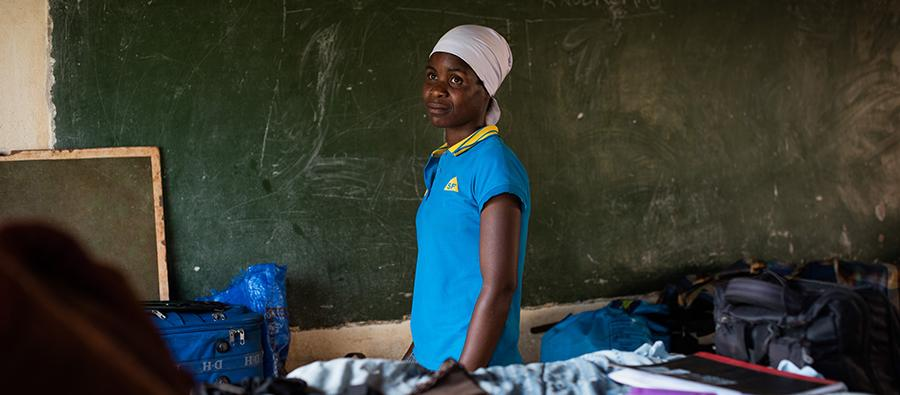 "When cyclone Idai hit Zimbabwe, Shoorai, 23, spent the night standing on a bed with her children, surrounded by the floodwaters in the darkness. ""Many of my neighbors died. It was grace that we survived."" Photo: Philip Hatcher-Moore/Oxfam"