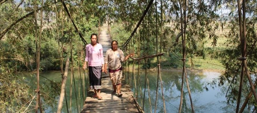 Two women crosss a bridge, Laos