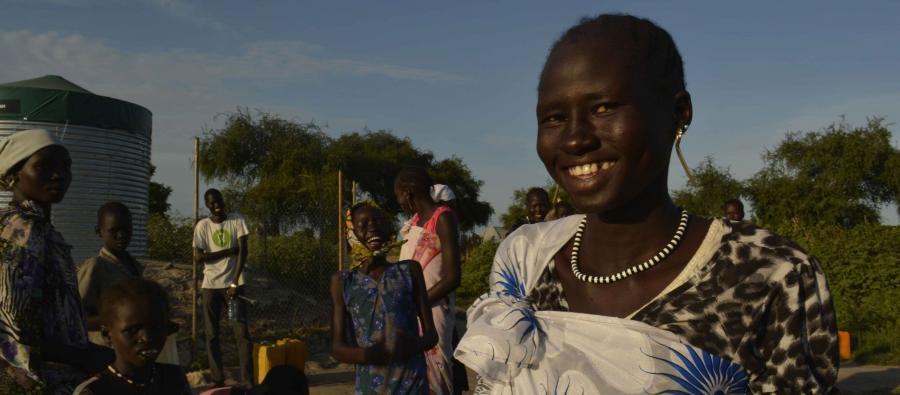 Nyawol Piu collects water from an Oxfam water tank in Jonglei state.
