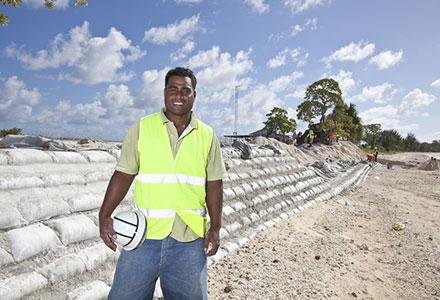 A worker who helped to construct coastal defences in  Tarawa, Kiribati