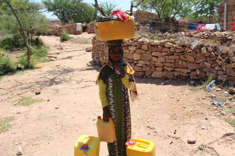 Aisha is unable to go to school because her family is poor and depends on her to wash the clothes and bring water from the wells.